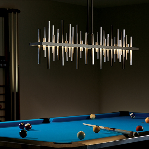 Cityscape light fixture hung over a pool table.
