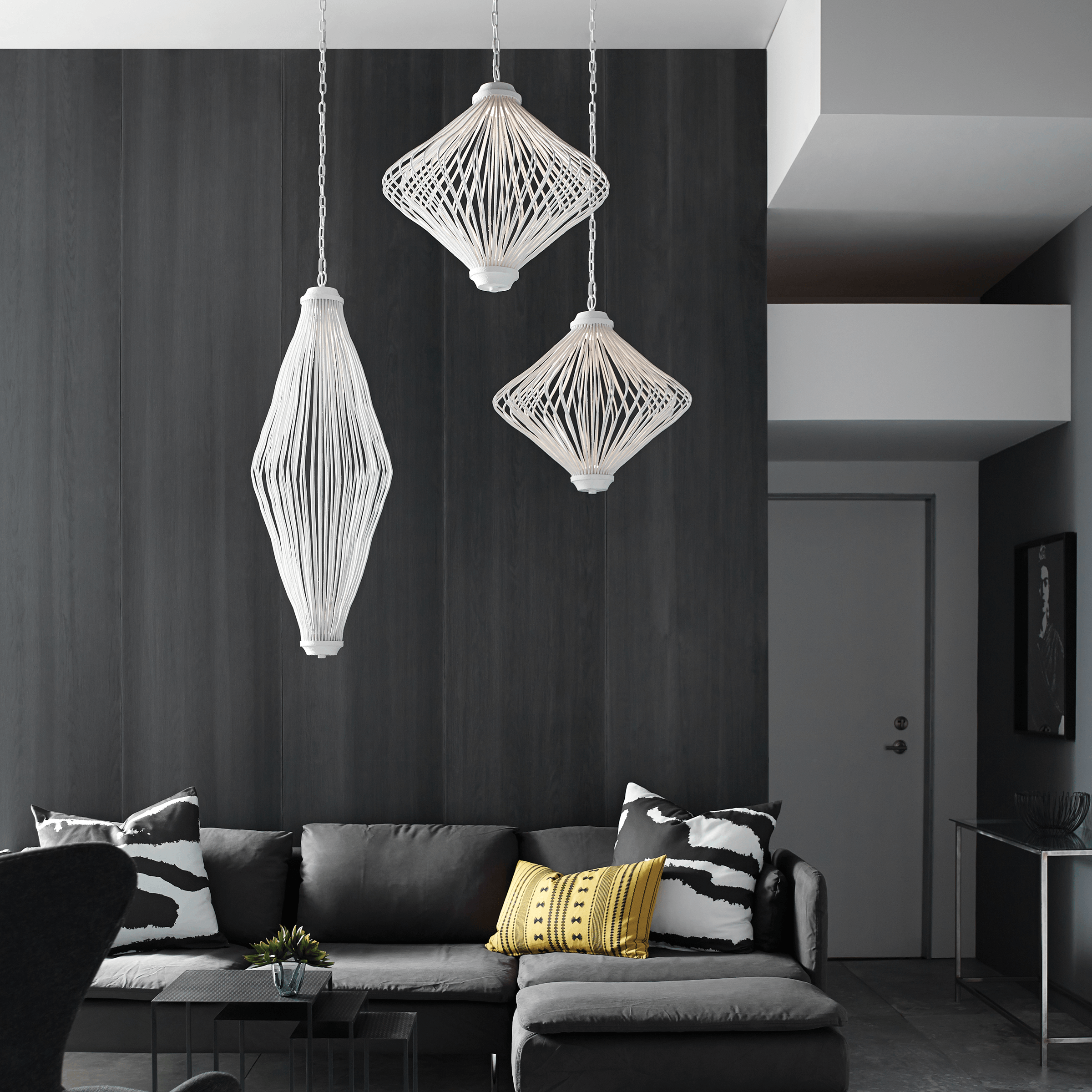 A cluster of three Kellen chandelier pendants by Feiss bring a fun yet elegant edge to this black and white living room.